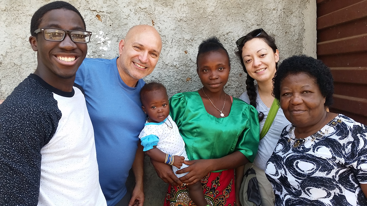 Michael, Brian and Regina, Rev. Enid of YVA Team '17 with baby Chelsea (whose birth was witnessed last year by our Chelsea!)