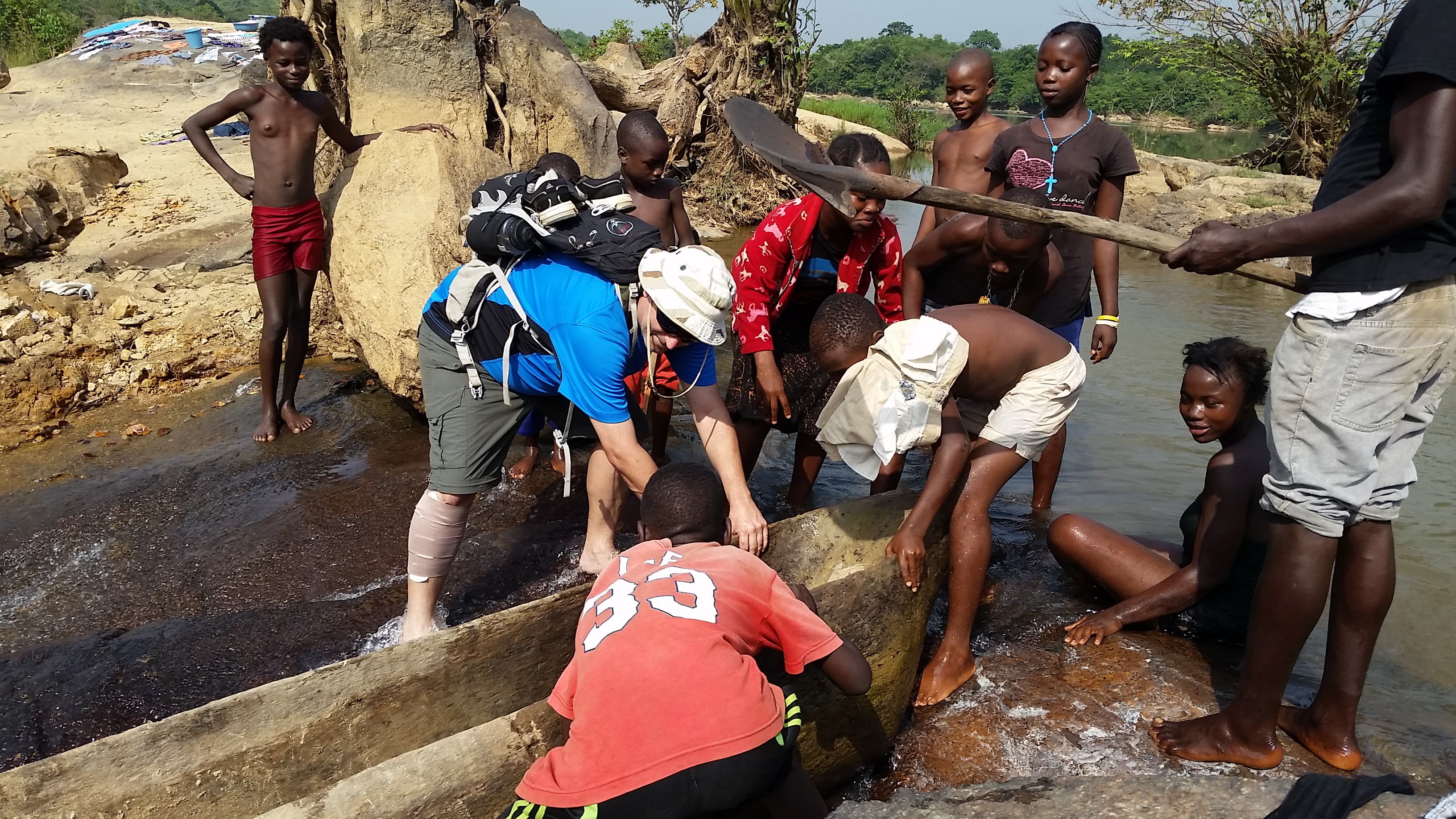 Brian helps some kids with their canoe on the Sewa river